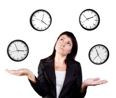 Businesswoman juggling clocks. Time Juggling Act.