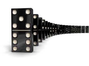 Domino - row of black dominoes on white